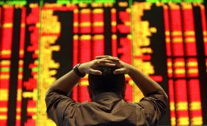 An investor reacts as he monitors the share index at a private stock market gallery in Kuala Lumpur on September 18, 2008. Share prices on Bursa Malaysia were broadly lower at mid-day amid a global sell-off triggered by growing concerns over the extent of the United States credit crunch and domestic political uncertainties, dealers said. AFP PHOTO (Photo credit should read AFP/AFP/Getty Images)