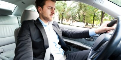 businessman-driving-car.jpg